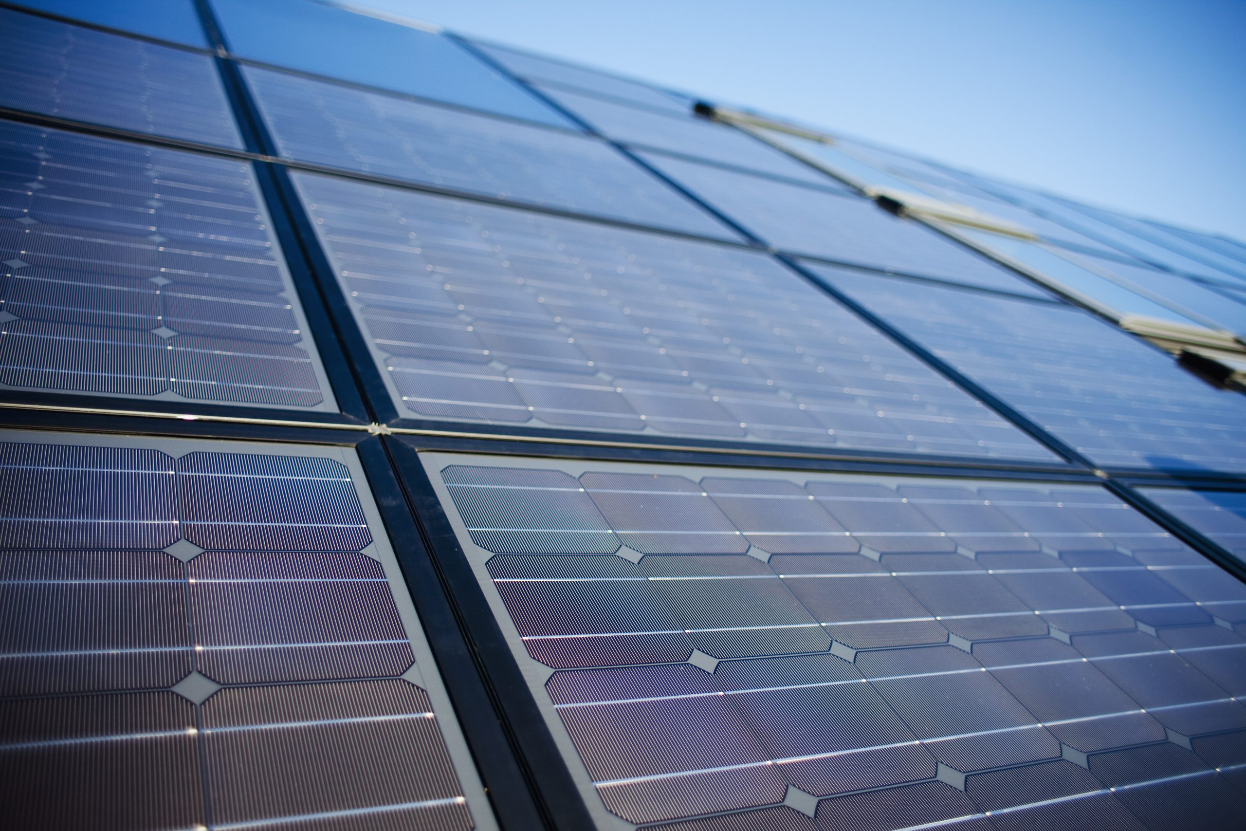 low-angle-view-of-solar-panels-against-sky-ED5WY8H-scaled.jpg
