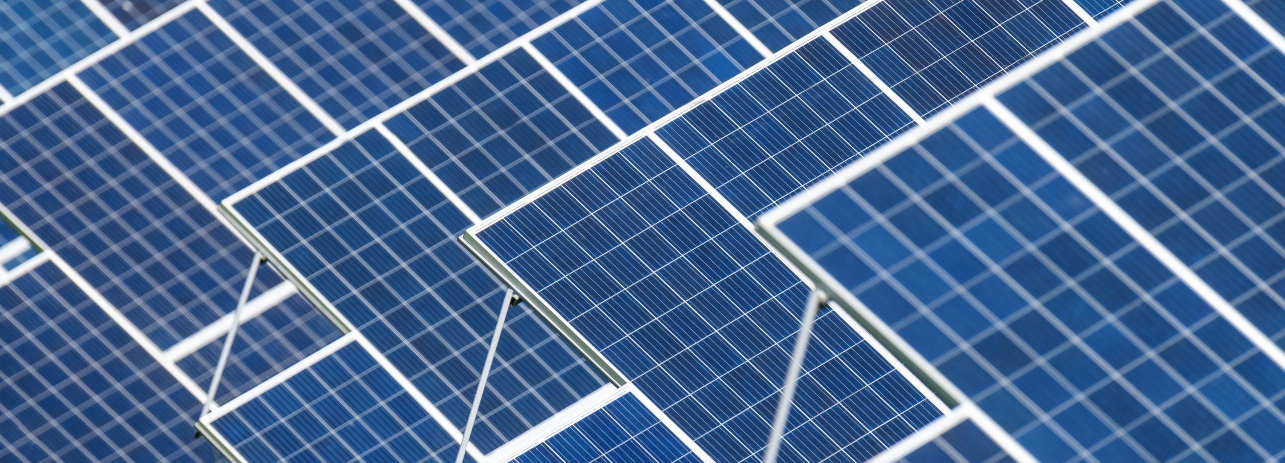 texture-solar-panels-generate-power-energy-J9CZEQM-scaled.jpg